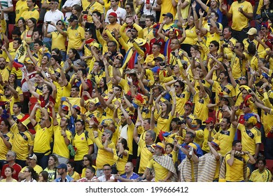 BRASILIA, BRAZIL - June 19, 2014: Soccer fans celebrating at the 2014 World Cup Group C game between Colombia and Ivory Coast at Estadio Nacional. No Use in Brazil.