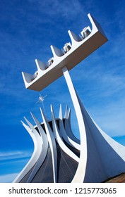 """Brasilia, Brazil - june 2018. The Cathedral of Brasilia: """"Metropolitan Cathedral of Our Lady of Aparecida"""" against blue sky. Architectural design by Oscar Niemeyer."""