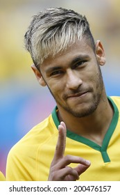 BRASILIA, BRAZIL - June 23, 2014: Neymar of Brazil during the 2014 World Cup Group A game between Brazil and Cameroon at Estadio Nacional Mane Garrincha. No Use in Brazil.