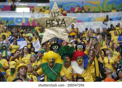 BRASILIA, BRAZIL - JUNE 23, 2014: Fans during the World Cup Group A game between Cameroon and Brazil in the National Stadium. NO USE IN BRAZIL.