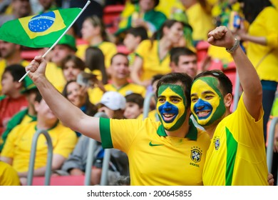 BRASILIA, BRAZIL - June 23, 2014: Brazil fans celebrating at the 2014 World Cup Group A game between Brazil and Cameroon at Estadio Nacional Mane Garrincha. No Use in Brazil.