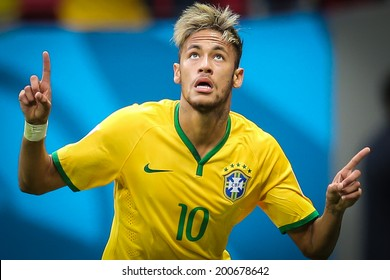 BRASILIA, BRAZIL - June 23, 2014: Neymar of Brazil celebrates after scoring a goal during the 2014 World Cup game between Brazil and Cameroon at Estadio Nacional Mane Garrincha. No Use in Brazil.