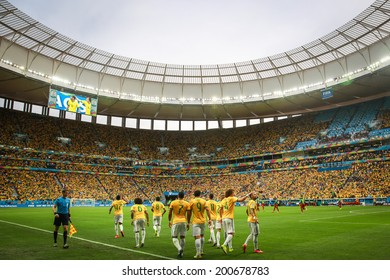 BRASILIA, BRAZIL - June 23, 2014: Brazil team celebrate after Fred's goal during the 2014 World Cup Group A game between Brazil and Cameroon at Estadio Nacional Mane Garrincha. No Use in Brazil.