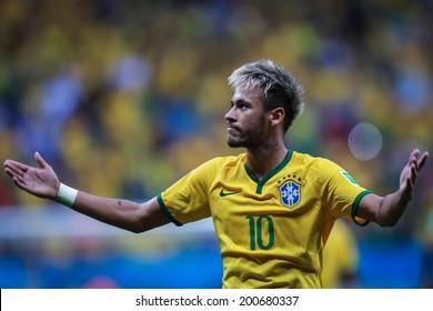 BRASILIA, BRAZIL - June 23, 2014: Neymar of Brazil celebrates after scoring a goal during the 2014 World Cup game between Brazil and Cameroon at Estadio Nacional Mane Garrincha. No Use in Brazil.