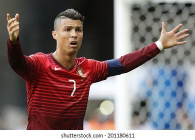 BRASILIA, BRAZIL - June 26, 2014: Cristiano Ronaldo on the 2014 World Cup Group G game between Portugal and Ghana at Estadio Nacional Mane Garrincha in Brazil. No Use in Brazil