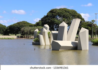 Brasilia, DF, Brazil - March, 12, 2019: Trees, lake and a beatiful blue backgroun in the military sector of Brasilia (setor militar de Brasilia).