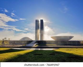 Brasilia, DF, Brazil. November, 13th, 2017. Oscar Niemeyer  Congresso Nacional building during sunrise with fog.
