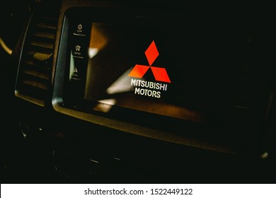 Brasilia, Federal District - Brazil.  Circa, September, 2019. Photo of the interior of a Mitsubishi Lancer GT 2015 vehicle. Highlight for the japanese company logo on infotainment,