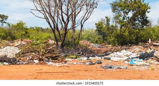 Brasilia, Federal District - Brazil. January, 23, 2021. A lot of rubbish and rubble on land on the dirt and undergrowth. Photo for the concept of Pollution and environmental preservation.