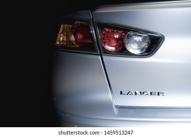 Brasilia, Federal District - Brazil. July 23, 2019. Rear photo of Mitsubishi Lancer GT model silver color 2015. Focus on the letters.