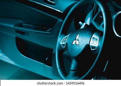 Brasilia, Federal District - Brazil. July 23, 2019. Photo of the interior of a Mitsubishi Lancer GT model 2015 car. Focus on the brand logo.