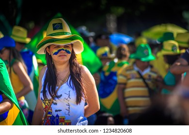 Brasilia/DF/Brazil - 04-17-2016: Baiana with face painted in the colors of the Brazilian flag awaiting the vote of the Impeachment of Dilma Rousseff