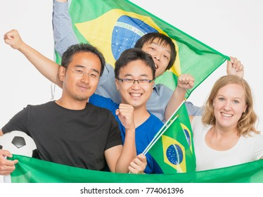 Brasilian football fans happy and smiling, isolated on white background.
