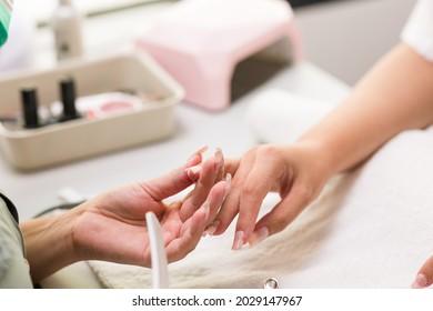 Brasilian latin mid woman manicure profesional file nailfiberflass nails to a client autumn evoque