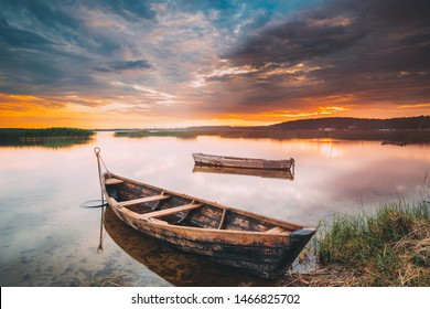 Braslaw Or Braslau, Vitebsk Voblast, Belarus. Wooden Rowing Fishing Boats In Beautiful Summer Sunset On The Dryvyaty Lake. This Is The Largest Lake Of Braslav Lakes. Typical Nature Of Belarus.
