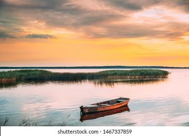 Braslaw Or Braslau, Vitebsk Voblast, Belarus. Wooden Rowing Fishing Boat In Beautiful Summer Sunset On The Dryvyaty Lake. This Is The Largest Lake Of Braslav Lakes. Typical Nature Of Belarus.