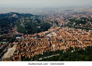 Brasov city aerial panoramic view. Transylvania, Romania. Orange rooftops famous destination, tourist attraction old european city scenic postcard.
