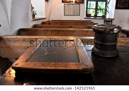 BRASOV - JUNE 7: The first Romanian school in the country is located in Brasov. Built in 1495, the school contains original objects like slate chalkboards and desks. On June 7, 2013 in Brasov, Romania