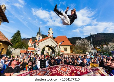 Brasov, Romania: 13 April, 2018 - The throwing of the youth at Junii Brasovului festival.