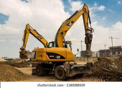 Brasov, Romania- 15 September 2018: Caterpillar excavators close up shot on construction site.