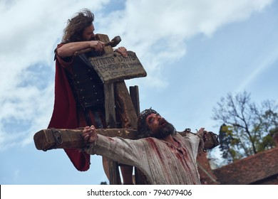 Brasov, Romania - April 14, 2017: Actor plays Jesus Christ crucified during the street reenactment of the Stations of the Cross on Good Friday.