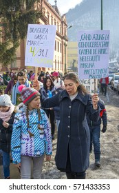 Brasov, Romania - February 04, 2017: Mother explaining to her daughter why fihting against coruption it's so important for their future.