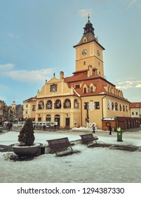 Brasov, Romania - January 20, 2019: The Brasov County Museum of History (former Council House) building in the snowy Council Square in the historic center of the medieval city.