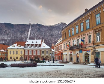 Brasov, Romania - January 20, 2019: Snowy Council Square in the historic center of the medieval city at the base of Tampa mountain, 7th largest and the most visited town in Romania.