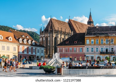 BRASOV, ROMANIA - JULY 05, 2017: In Brasov Council Square (Piata Sfatului) Are Located The Council House, The Old Town And The Black Church