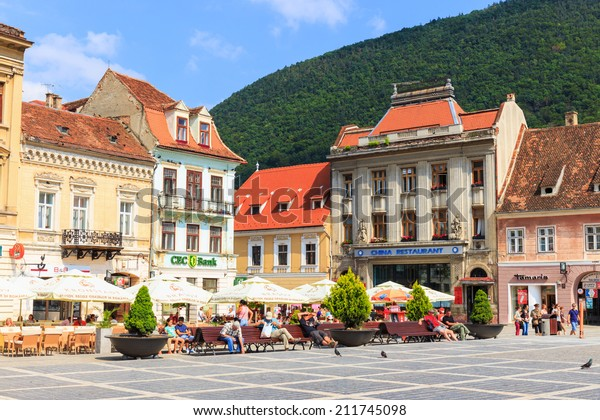 BRASOV, ROMANIA - JULY 15: Council Square on July 15, 2014 in Brasov, Romania. Brasov is known for its Old Town includes the Black Church, Council Square and medieval buildings.