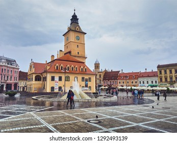 Brasov, Romania - July 9, 2018: Brasov County Museum of History (former Council House) building in the Council Square (Piata Sfatului) in the historic center of the old medieval city, on a rainy day.
