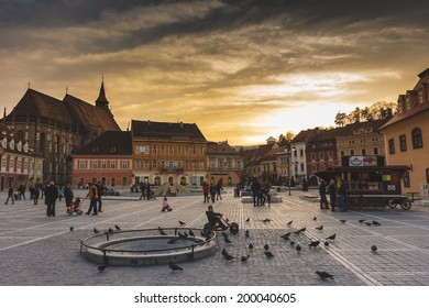 BRASOV, ROMANIA - MARCH 1: Council Square on March 1, 2014 in Brasov, Romania. Beautiful sunset in the Old Town which includes the Black Church, Council Square and medieval buildings.