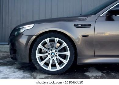Brasov , Romania march 7th 2011grey Bmw M5 with dark windows and silver magnesium wheels.