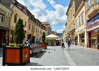 BRASOV, ROMANIA - MAY, 2018.  Old Town of Brasov with stores and restaurants, amazing tourists attraction in Brasov city, Romania.