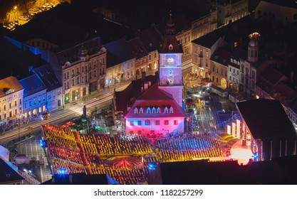 Brasov, Romania - September 1, 2018: Twilight bird's eye view of the Golden Stag (Cerbul de Aur) International Festival at its 50th anniversary, in the Council Square of Brasov city, Romania.
