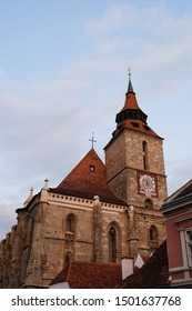 Brasov, Romania September 1 2019  Black Church in the old town square in beautiful sunset light