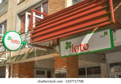 """Brasov, Romania,10 March 2019 - Front view of """"Loteria romana"""" agency. Romanian lottery.Loto sign and logo.Four leaf clover logo"""