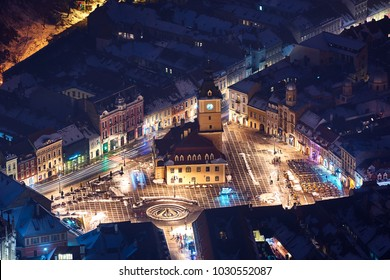 Brasov, Transylvania. Romania. Panoramic view of the old town and  Council Square, Aerial twilight cityscape of Brasov city, Romania