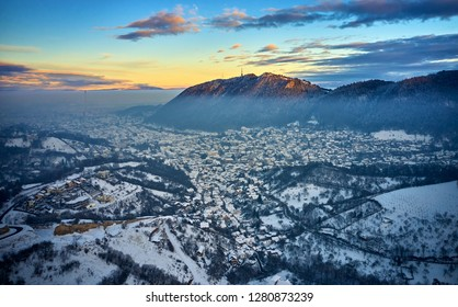 Brasov, Transylvania. Romania. Panoramic view of the old town and Council Square in the winter time, Aerial cityscape of Brasov city, Transylvania landmark in Romania