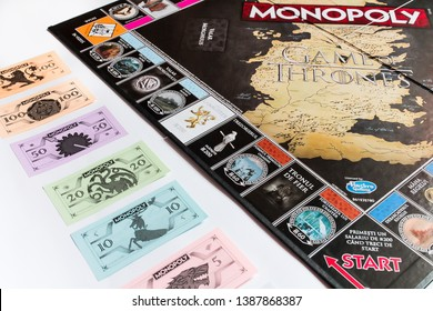 Brasov/Romania - 5/3/2019: Game of Thrones Edition Monopoly Board Game, Collector's Edition, Romanian version, flatlay, game board with money isolated on white background