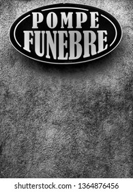 """Brasov/Romania - July 12 2017: Undertaker sign in Romanian """"Pompe Funebre"""" on a street in Brasov, Romania. Black and white filter applied."""