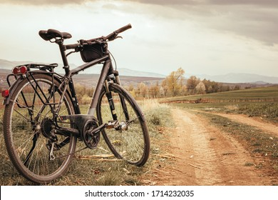 Brasov/Romania-April,01,2020: Touring Cube  bike on a country road under a cloudy sky