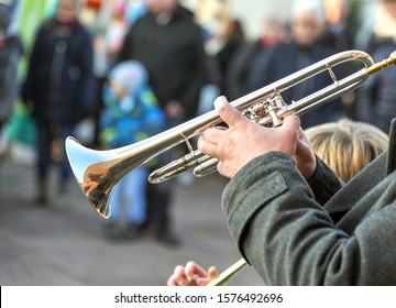 Brass band music outdoors - close up musician with trombone on an public event, selective focus