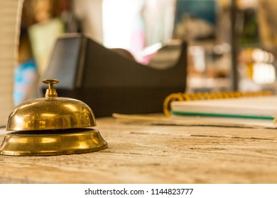 Brass bell on wooden counter