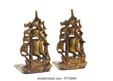 Brass bookends in the shape of ancient sailing ships