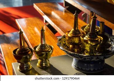 Brass Bottle And Bowl Sets Used For Pouring Water As A Dedication Of Merit. Thai Bhudda Culture