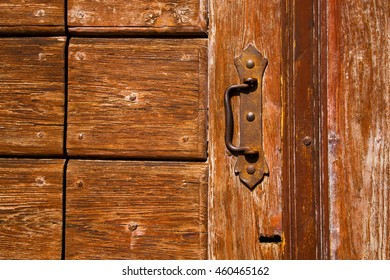 a brass brown knocker and wood door cairate varese italy