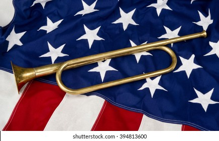 Brass bugle on a American flag.