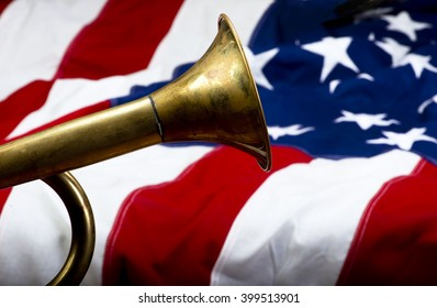 Brass bugle on a American flag with room for your type.