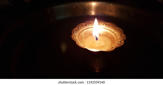 Brass candle or jyoti, diya of our home, It our Indian tradition to glow brass candle with pure ghee.